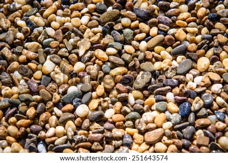 Wet shining pebbles background on floor at temple  - stock photo