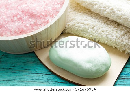 wet soap with foam on blue wooden background, Spa - stock photo