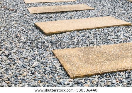 Wet stone pathway in the garden after rain - stock photo