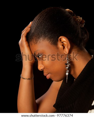Wet tears running of the face of a young african woman - stock photo