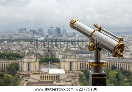Wet telescope on top the Eiffel Tower. View of the city Paris at the prospect of the gallery Eiffel tower.