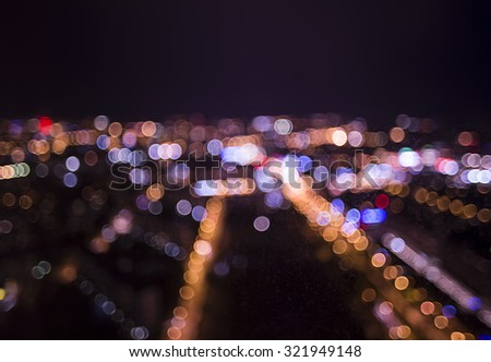 Wet the window with the background of the night city - stock photo