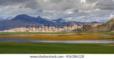Wetlands and lake forming part of the beautiful landscape of Western Tibet - stock photo