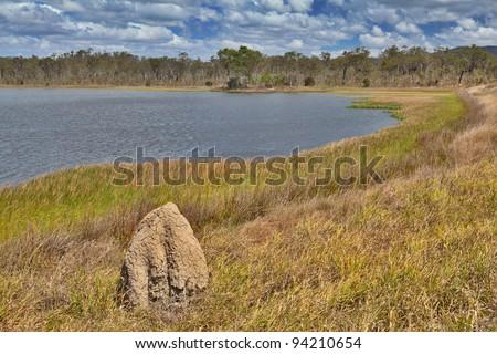 wetlands billabong Australian swamp lake Queensland Australia panorama landscape wilderness hike termite hill - stock photo