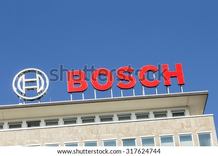 WETZLAR, GERMANY - JULY 2, 2015: the letters Bosch at the Headquarter in Wetzlar, Germany are 18 meters long and 2,50 meters high. They are illuminated with modern LED lights. - stock photo