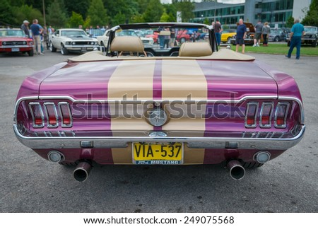 WEYBRIDGE, SURRY, UK - AUGUST 18: Purple and gold Classic Ford Mustang cabriolet rear view on show at the annual Brooklands Motor Museums Mustang and Anything American Day in August 2013 - stock photo