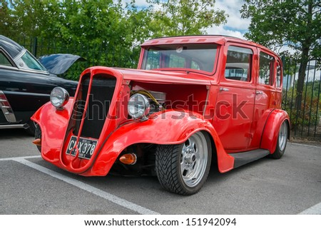 WEYBRIDGE, SURRY, UK - AUGUST 18:  Red 1935 Ford Model CX Saloon on show at the annual Brooklands Motor Museums Mustang and Anything American Day in August 2013. - stock photo