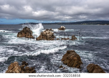 Whaler's Cove at Point Lobos State Reserve, with aquamarine waters & rock formations, huge waves, along the rugged Big Sur coastline, near Carmel and Monterey, CA. on the California Central Coast. - stock photo