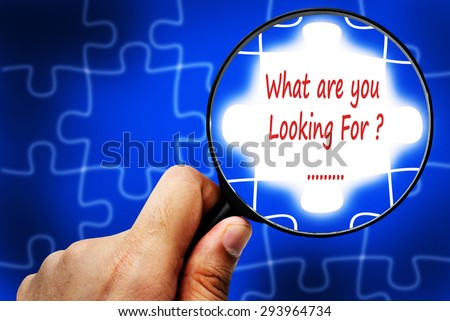 What are you Looking For word. Magnifier and puzzles. - stock photo