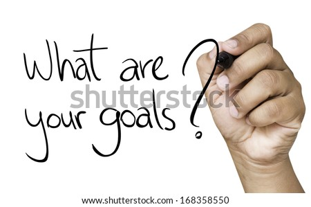 What are your goals hand writing with black marker on transparent wipe board - stock photo
