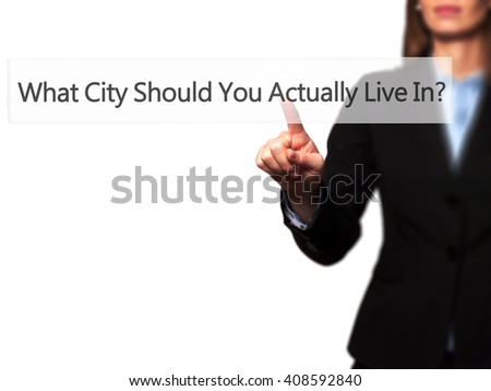 What City Should You Actually Live In - Businesswoman hand pressing button on touch screen interface. Business, technology, internet concept. Stock Photo
