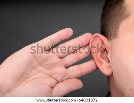 What? Closeup for hand on ear - stock photo