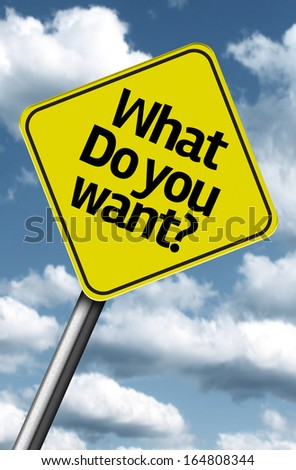 What do you want creative sign on a beautiful blue sky - stock photo