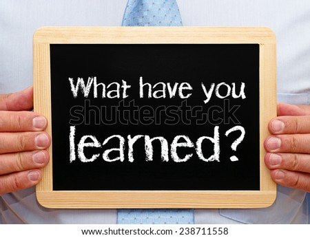 What have you learned ? - Businessman with chalkboard