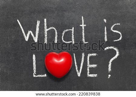 what is love question handwritten on blackboard with heart symbol instead of O