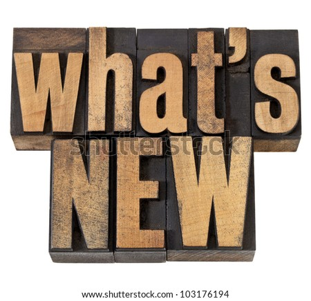 what is new - news concept - isolated phrase in vintage letterpress wood type - stock photo