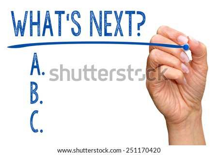 What is next ? Checklist with female hand on white background - stock photo