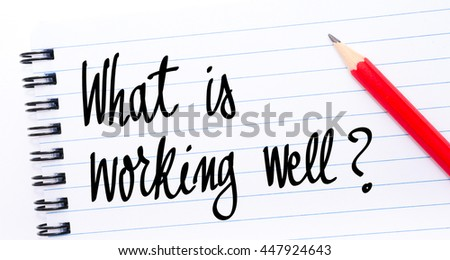 What Is Working Well ? written on notebook page with red pencil on the right