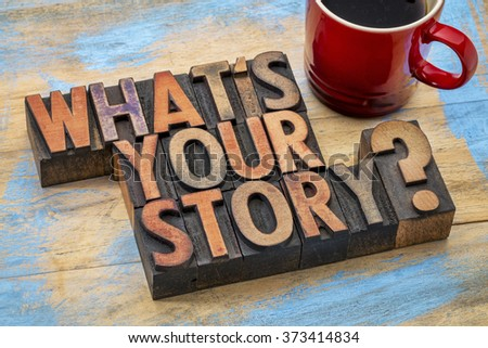 what is you story question - text in vintage letterpress wood type printing blocks with a cup of coffee - stock photo
