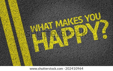 What Makes You Happy? written on the road - stock photo