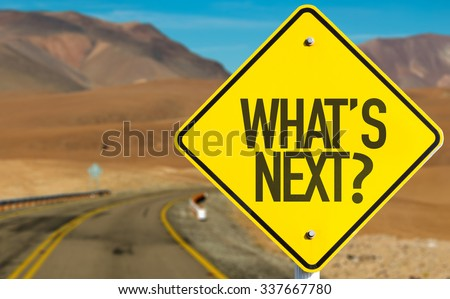 What's Next? sign on desert road - stock photo