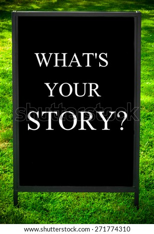 WHAT'S YOUR STORY?  message on sidewalk blackboard sign against green grass background. Copy Space available. Concept image