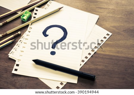 What's Your Story, Question Mark on papers with many pencils - stock photo