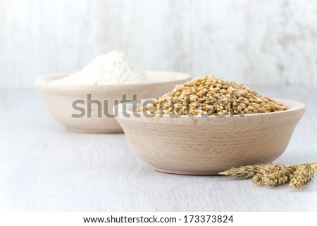 Wheat and flour on the table - stock photo