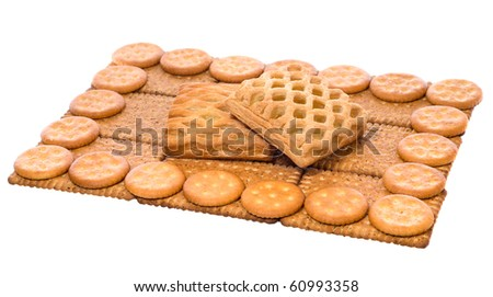 wheat biscuits and split cookies on top (food composition)  isolated on white background