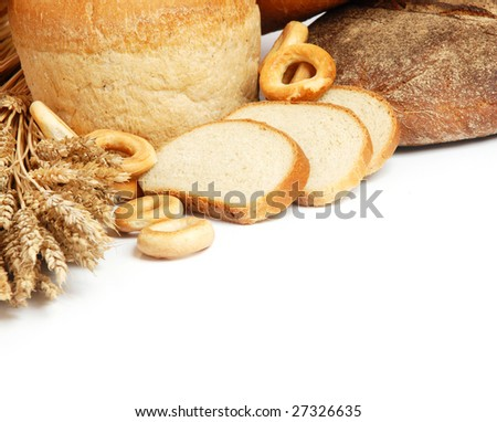Wheat, bread, milk and eggs on a white background