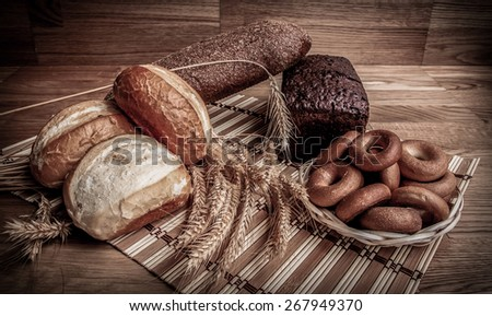 wheat bread on wooden background - stock photo
