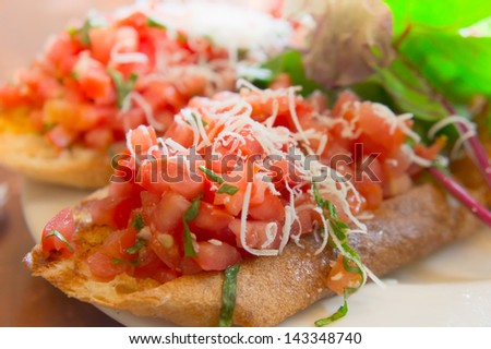 Wheat bruschetta with diced tomato salsa - stock photo