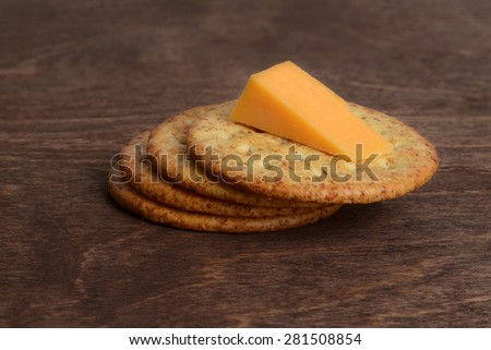wheat crackers with cheddar cheese - stock photo