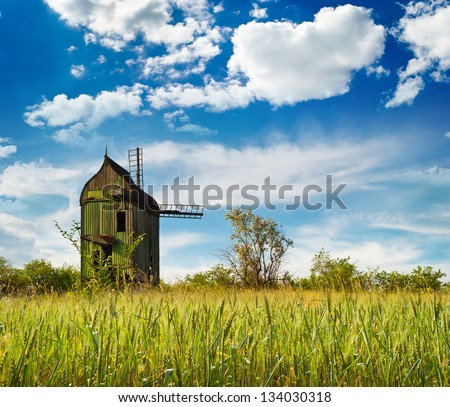 wheat field near the mill. Composition of nature - stock photo