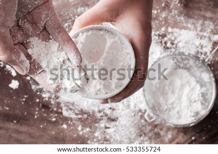 Wheat flour in a bowl holding by hand,food ingredient, prepare for cooking or baking
