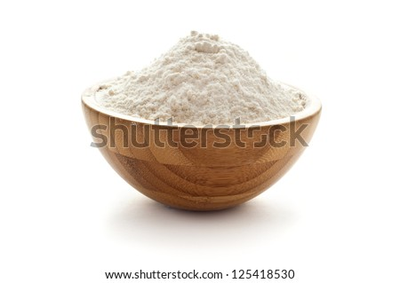 wheat flour in wooden bowl - stock photo