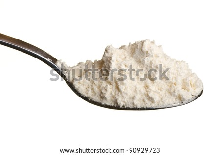 Wheat flour or other white powder in a spoon isolated over white background
