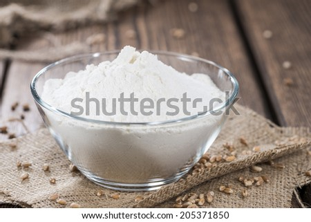 Wheat Flour (small portion) on dark vintage wooden background