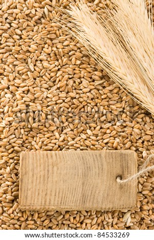 wheat grain and spike ear with wood - stock photo