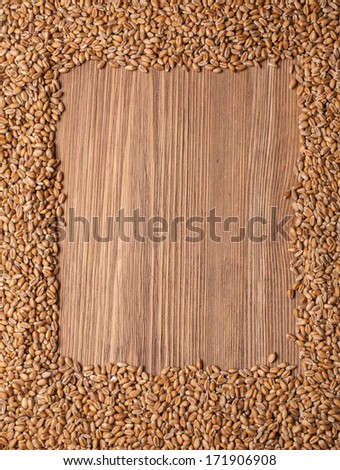 wheat grain on wood texture background - stock photo