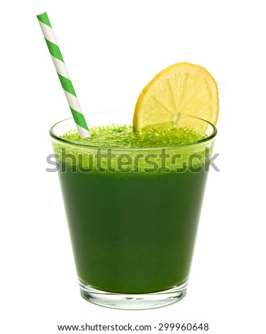 Wheat grass juice with lemon slice and straw in glass on white background - stock photo