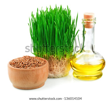 Wheat green sprouts, wheat seeds in the wooden bowl and wheat germ oil isolated on white background - stock photo