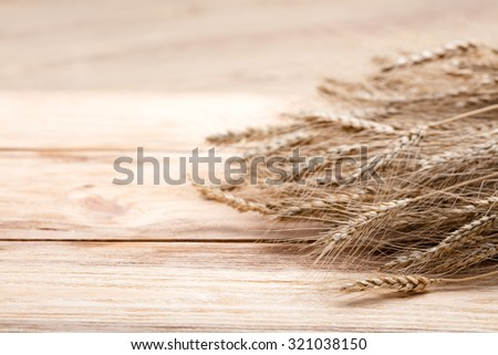 wheat on wooden background - stock photo