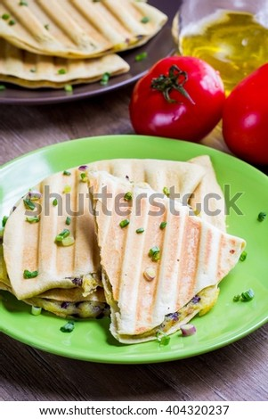 Wheat tortillas on grill, with potatoes and onions, bread, snack, tasty flat bread for picnic