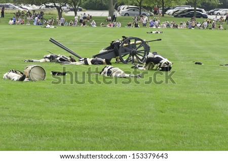 WHEATON, ILLINOIS/USA - SEPTEMBER 7: American Revolutionary War (1775-1783) reenactment on September 7, 2013, in Wheaton, IL. Actor-soldiers of Continental Army run past fallen comrades in battle..