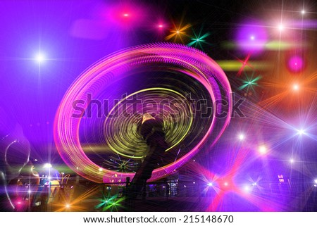 wheel against a black sky - stock photo