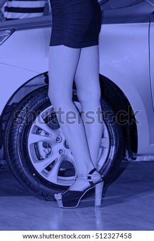 wheel and sexy high heels, closeup of photo