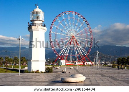 wheel and the lighthouse on the seafront Batumi, Georgia - stock photo