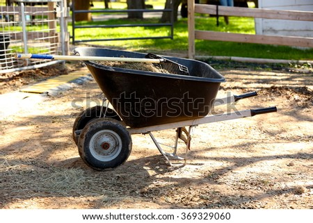 Wheel barrow with rack