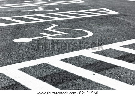 Wheel chair symbol in parking lot - stock photo